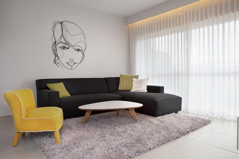 הלבשת דירת קבלן בעזרת ריהוט, צבע, וילונות ופרטי אומנות