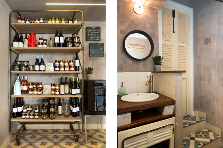 עגלת שירות תצוגת מוצרים למכירה יינות בוטיק וריבות מקומיות. כניסה לשירותים דלת עשויה תריס ישן