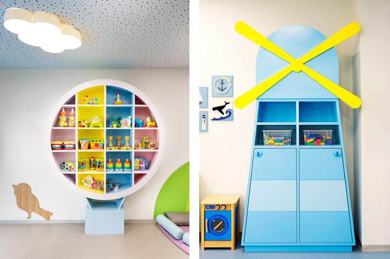ארון אחסון בצורת כדור פורח בגוונים שונים בתינוקייה ויחידת אחסון בכיתת הביניים בצורת מגדלור עשוי עץ צבוע תנור