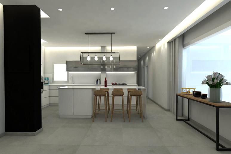 מבט מאזור הסלון אל המטבח חושף אי ארוך המאפשר לוותר על פינת האוכל הקונבנציונאלית