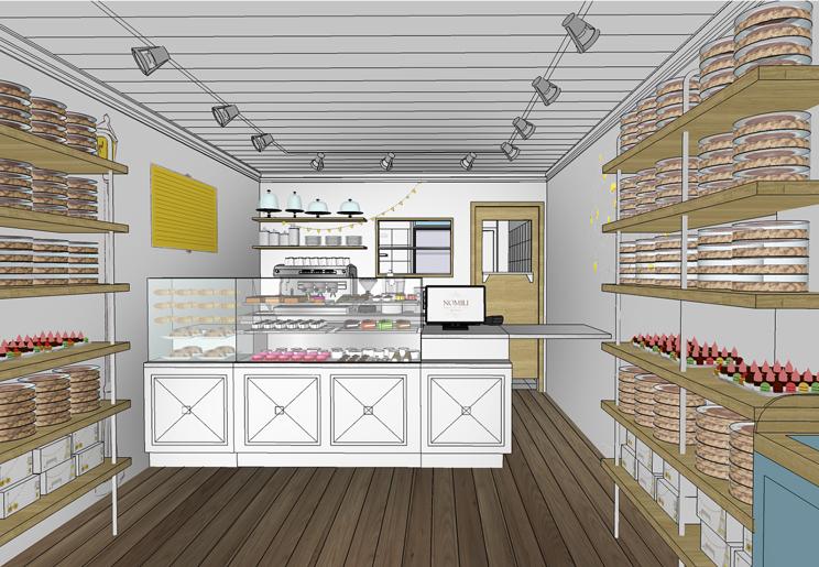 מבט מהכניסה לחנות חושף מדפי תצוגה רבים לעוגות, עוגיות ומוצרים נילווים